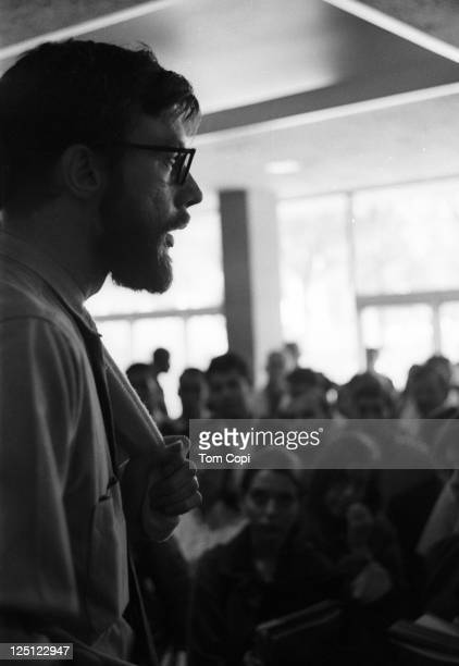 Activist Carl Oglesby gives a speech at an anti-war rally at the University of Michigan in Ann Arbor, Michigan in 1965.