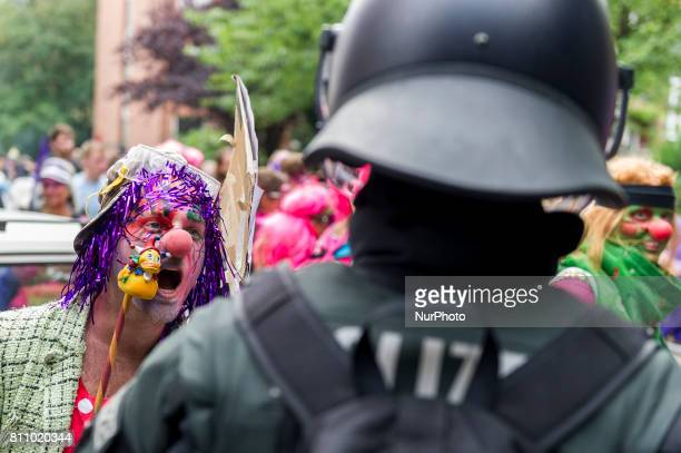 A activist clown is speaks with a policemen in Hamburg Germany on July 7 2017 Activists tried to enter the red security zone in the action astreet...