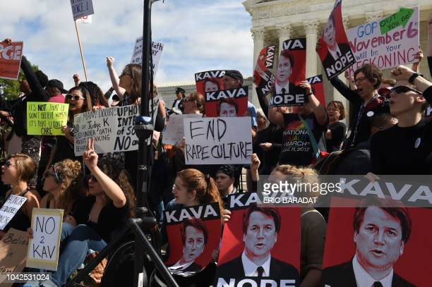 TOPSHOT Activist demonstrate against US Supreme Court nominee Brett Kavanaugh in front of the court in Washington DC on September 28 2018