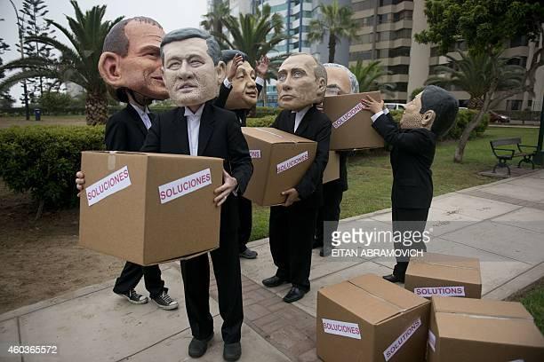 Activist depicting Australia's Prime Minister Tony Abbot Canada's Prime Minister Stephen Harper China's President Xi Jinping Rusia's President...