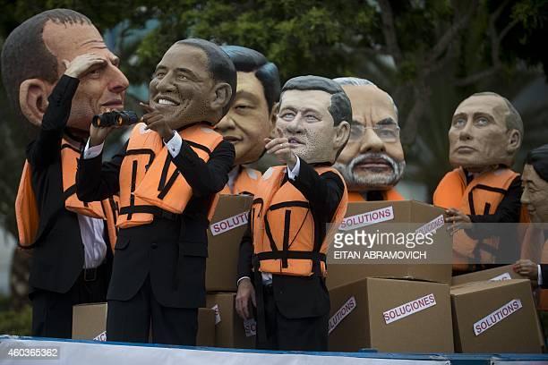 Activist depicting Australia's Prime Minister Tony Abbot US President Barack Obama China's President Xi Jinping Canada's Prime Minister Stephen...