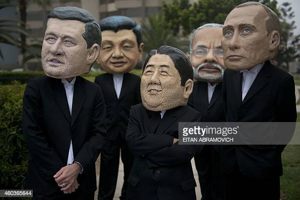 Activist depicting Canada's Prime Minister Stephen Harper China's President Xi Jinping Rusia's President Vladimir Putin India's Prime Minister...