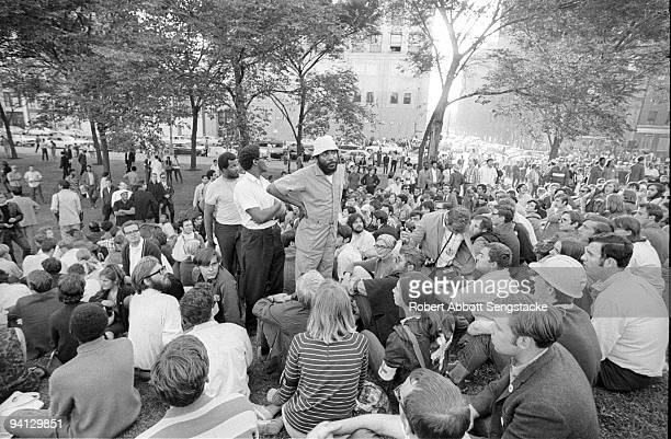 Activist Dick Gregory stands and looks upon a growing crowd of protestors gathered in Grant Park during the Democratic National Convention Chicago IL...
