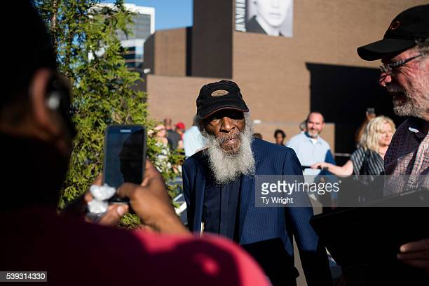 Activist Dick Gregory walks in with others at the Muhammad Ali Center on June 10 2016 in Louisville Kentucky After the funeral and the eulogy people...