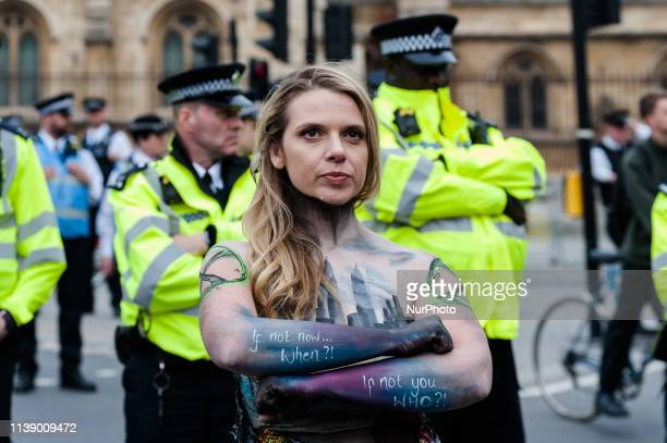 Activist from Extinction Rebellion stands in front of police cordon in Parliament Square on the ninth day of protest action on 23 April, 2019 in...