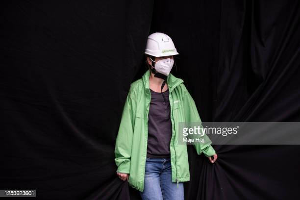 Activist from Greenpeace protests against upcoming coal legislation while standing in front of the party headquarters of the German Christian...