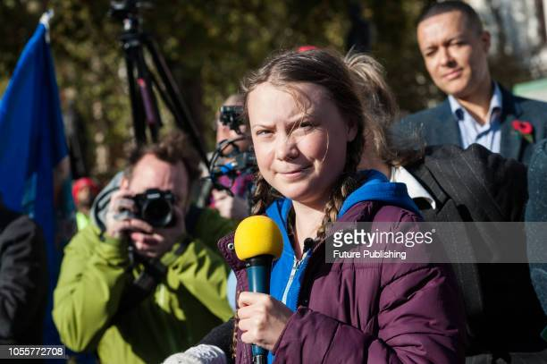 Activist Greta Thunberg addresses hundreds of activists and campaigners in London's Parliament Square during 'Extinction Rebellion' protest against...