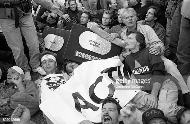 AIDS activist group ACT UP protest at the headquarters of the Food and Drug Administration on October 11 1988 in Rockville Maryland The action called...