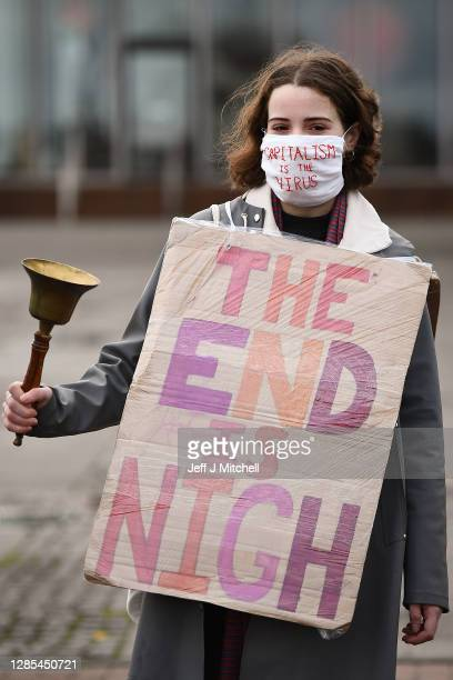 Activist hold a demonstration marking the delayed COP26 UN climate negotiations on November 13, 2020 in Glasgow, Scotland. The 26th United Nations...