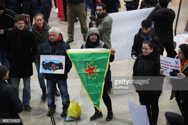 Activist holds a flag of the women's resistance forces About 3040 people protested spontaneously at the Munich Central Station against turkish war...