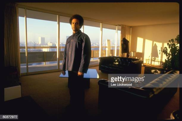 Activist Huey P Newton with Afro haircut in his penthouse living room