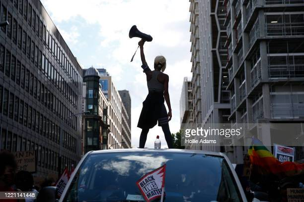 Activist Imarn Ayton stands on top of a car during an anti-racism protest near Trafalgar Square on June 20, 2020 in London, United Kingdom. Black...