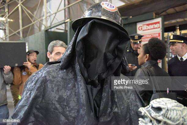 Activist in death costume Members of the building construction trades council of greater New York rallied along with Teamsters SEIU striking Verizon...