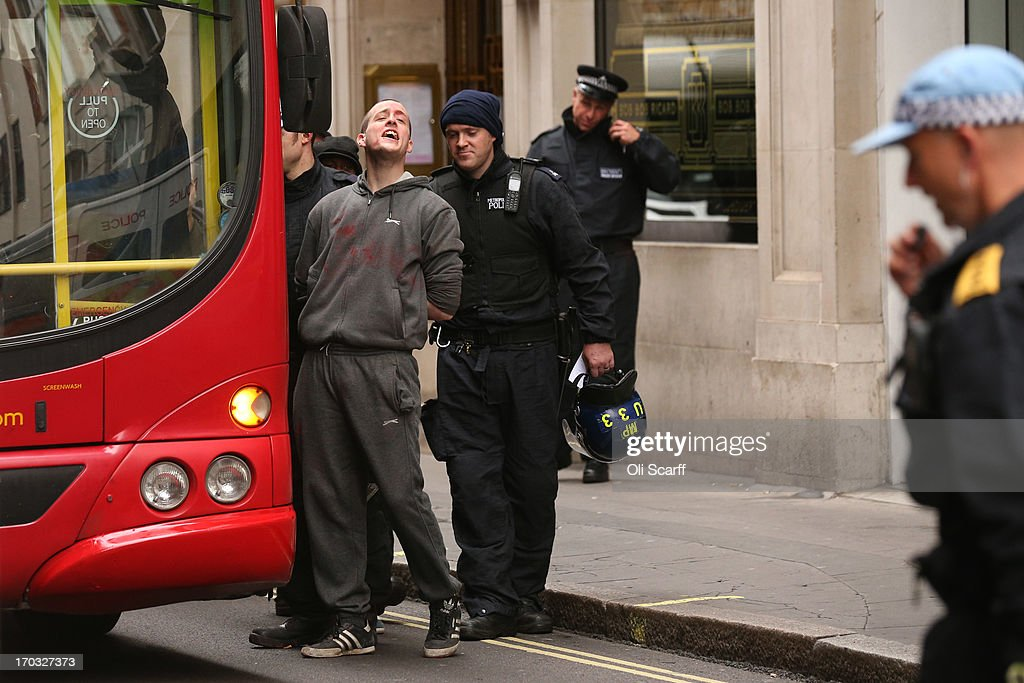 A activist is detained by police and put onto a bus on Golden Square after they occupied a convergence centre of the Stop G8 protest group off Beak Street ahead of next week's G8 summit in Northern Ireland on June 11, 2013 in London, England. Next week will see Enniskillen in Northern Ireland host the two day G8 summit where international leaders including Britain's Prime Minister David Cameron and US President Barack Obama take part in the two day event. The chosen location is only 8 kilometers from the scene of one of Northern Ireland's worst killings back in 1987, however Cameron is confident that it's secluded location will deter any potential trouble.