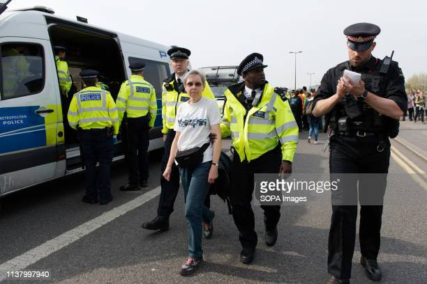 Activist is seen being arrested by police officers after refusing to head to Marble Arch during the Extinction Rebellion Strike in London...
