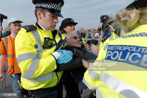 Activist is seen being removed by the police after refusing to head to Marble Arch during the Extinction Rebellion Strike in London Environmental...
