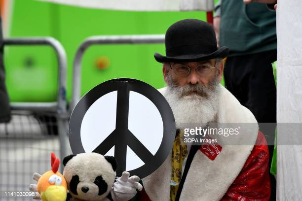 Activist is seen holding a placard with dolls during the protest Antinuclear activists gathered opposite Westminster Abbey in London to protest...