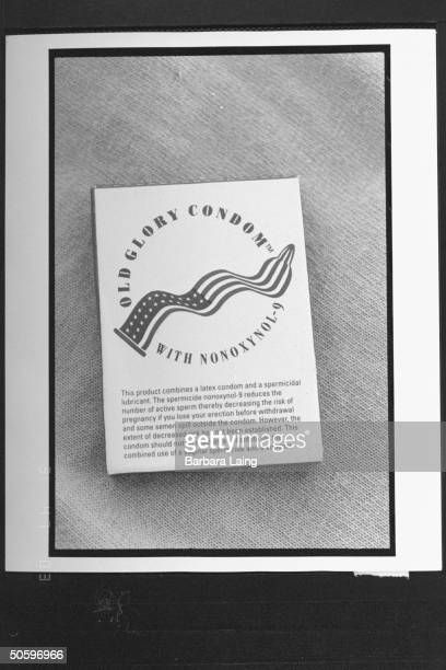 AIDS activist Jay Critchley creator of the Old Glory Condom co holding Amer flag as he stands on hill the US Patent Trademark Office initially...