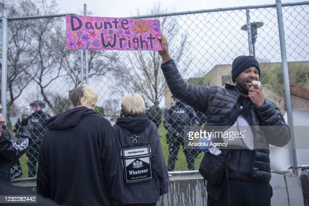 Activist Jonathan Mason holds a Daunte Wright sign in front of the crowd of protesters that gathered to protest the police killing of Daunte Wright...