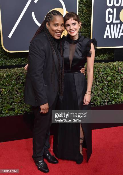 Activist Marai Larasi and Emma Watson attend the 75th Annual Golden Globe Awards at The Beverly Hilton Hotel on January 7 2018 in Beverly Hills...