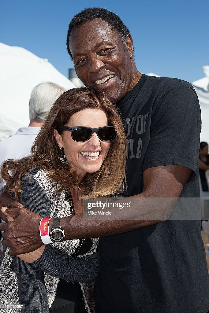 Activist Maria Shriver and athlete Rafer Johnson laugh during the Special Olympics Southern California 14th Annual Pier Del Sol Event at Santa Monica Pier on October 14, 2012 in Santa Monica, California.