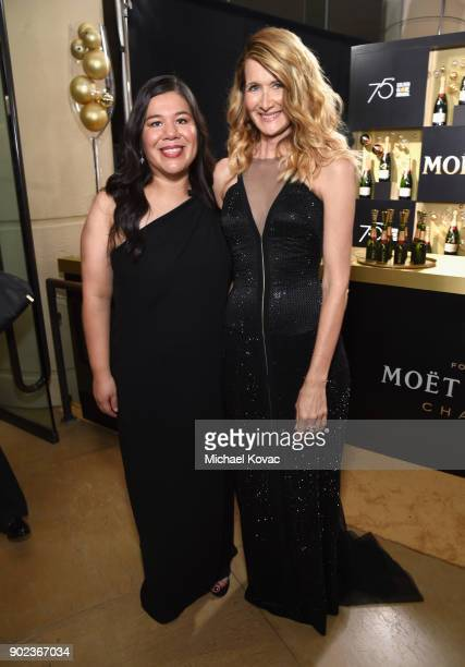 Activist Monica Ramirez and actor Laura Dern celebrate The 75th Annual Golden Globe Awards with Moet Chandon at The Beverly Hilton Hotel on January 7...