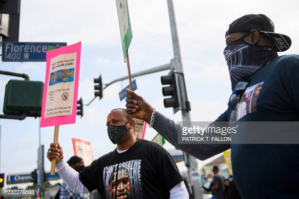 Activist Najee Ali and Timothy Goodman protest the killings of people by police including the death of George Floyd and Daunte Wright on April 12,...