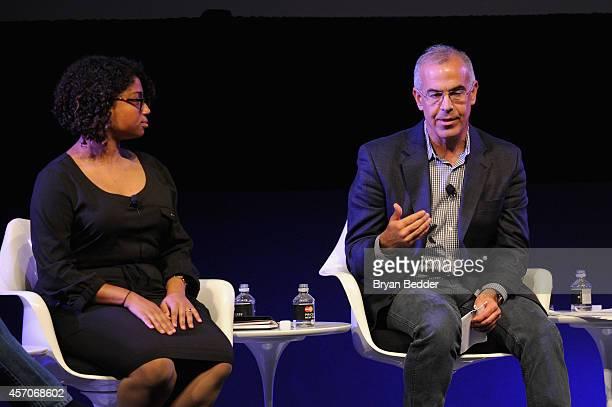 Activist Nelini Stamp and political comentator David Brooks speak on stage at Income Inequality with David Brooks Jacob Hacker and Nelini Stamp...