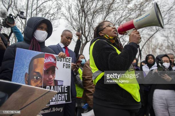 Activist Nola Darling talks on the megaphone in front of the Brooklyn Center police station at a protest over the police killing of Daunte Wright in...