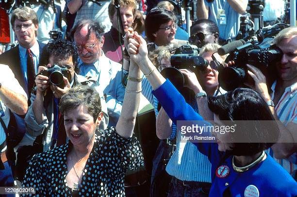 Activist Norma McCorvey and lawyer Gloria Allred raise their arms at a rally outside the United States Supreme Court Building Washington DC April 26...