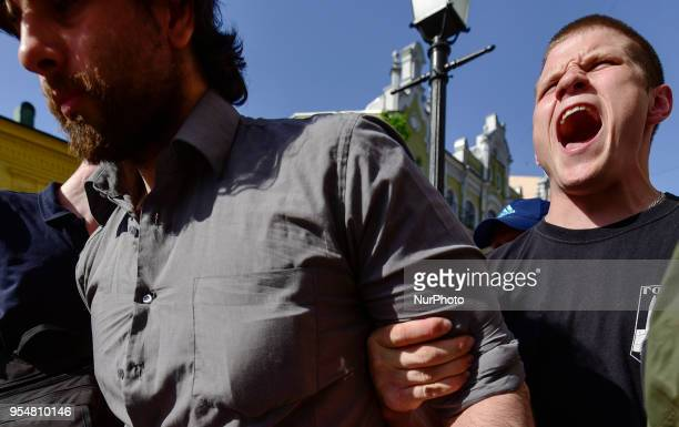 Activist of a Ukrainian farright movement scream the slogans as he holds a 33yearold Brazilian Rafael Lusvarghi a former volunteer fighter and poster...