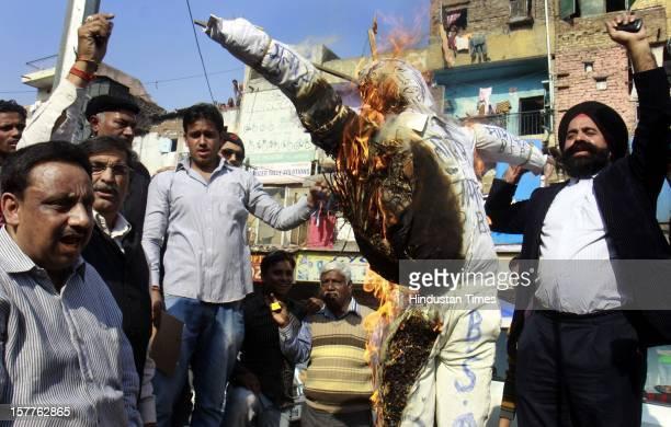 Activist of Confederation of All India traders and shop keepers raising slogans and burn effigy of Samajwadi Party and Bahujan Samaj Party and...