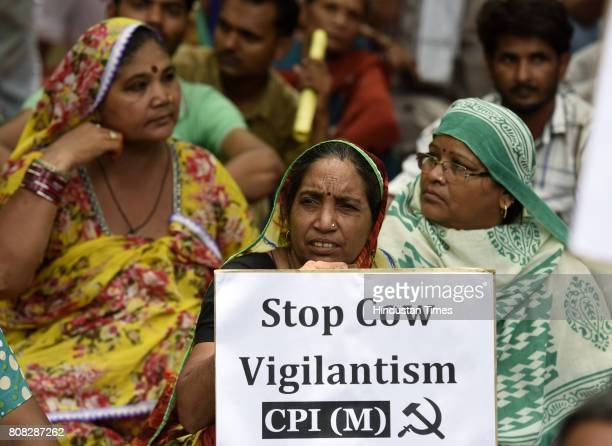 Activist of CPI sit at a protest against attacks on Muslim Minorities and Dalits and the ban on trade in cattle at Jantar Mantar on July 4 2017 in...