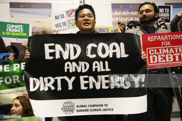 Activist of Global Campaign to Demand Climate Justice protested inside COP24 building against dirty energy and global warming Katowice Poland on 4...