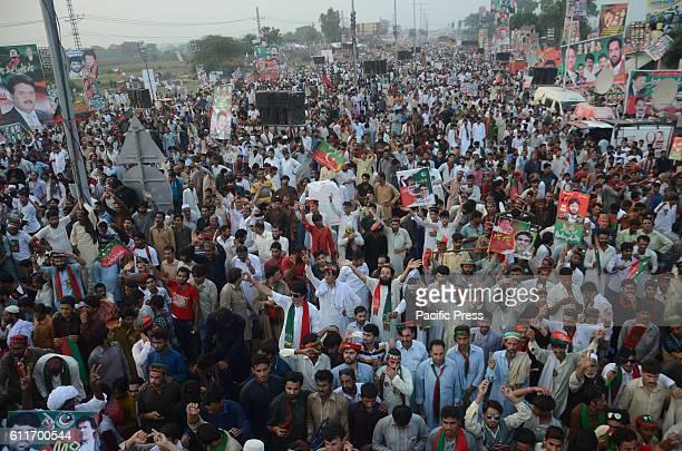 Activist of Pakistani TehreekeInsaf attend the an anti government rallySupporters of Pakistani cricketerturnedopposition leader Imran Khan react...