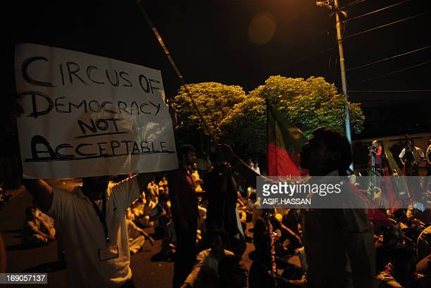 Activist of Tehreek-e-Insaf gather in a protest against the killing of party leader Zohra Hussain, in Karachi on May 19, 2013. Pakistani politician...