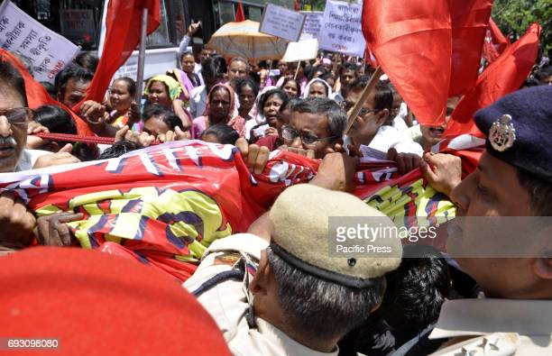 Activist of the Communist Party of India being whisked away by police while staging a protest demonstration, protesting against price hike on...