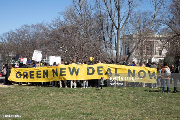 Activist outside the Congress demanding a vote to pass ' The Green New Deal'. The Senate is expected to vote Tuesday afternoon at 4:00 PM to begin...