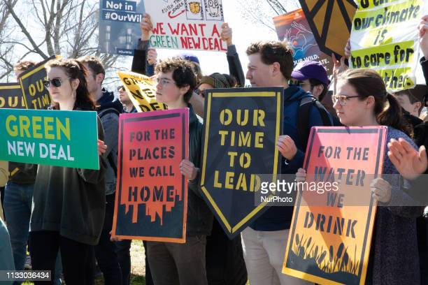 Activist outside the Congress demanding a vote to pass ' The Green New Deal' The Senate is expected to vote Tuesday afternoon at 400 PM to begin...