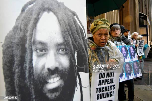 Activist Pam Africa speaks at a rally outside the District Attorneys Office in Philadelphia PA on December 12 2018 Two dozen rallied to call on DA...