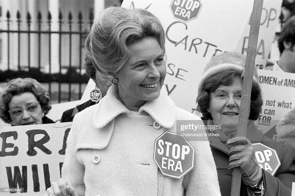 Activist Phyllis Schafly wearing a 'Stop ERA' badge during a demonstration with other women against the Equal Rights Amendment in front of the White House, Washington DC, February 4, 1977.