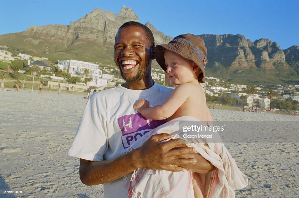 AIDS Activist Playing with Child : Stock Photo