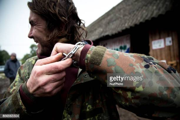 Activist prepares himself to action by putting chain on his hand quotCamp for Forestquot Pogorzelce near Bialowieza on September 22 2017