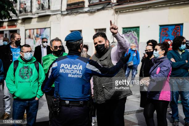 Activist protests to a police officer not to do anything when she sees that Elizabet threatens to throw herself off the balcony when the eviction of...
