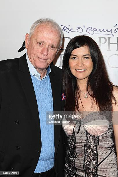 Activist Ric O'Barry and ARCA racer Leilani Munter arrive at the cocktail reception honoring Richard O'Barry on March 3 2012 in West Hollywood...