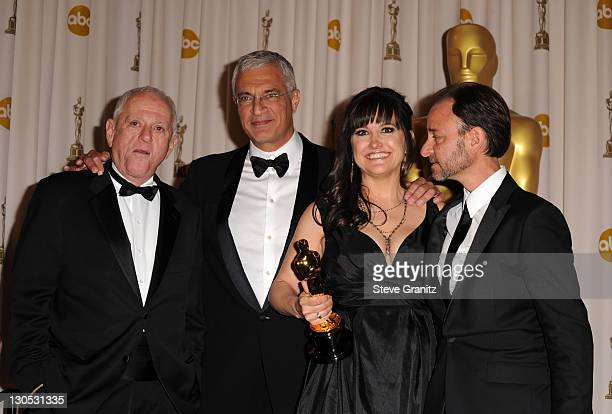 Activist Ric O'Barry director Louie Psihoyos producers Paula DuPre Pesman and Fisher Stevens pose in the press room at the 82nd Annual Academy Awards...