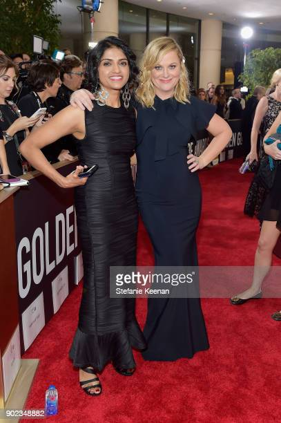 Activist Saru Jayaraman and actor Amy Poehler attends The 75th Annual Golden Globe Awards at The Beverly Hilton Hotel on January 7 2018 in Beverly...