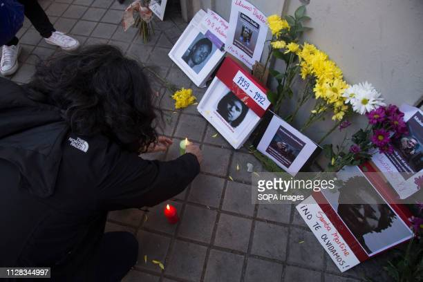 Activist seen lighting candles in memory of the dead immigrants during the protest Feminist movement protest as a preparatory action for the March 8...