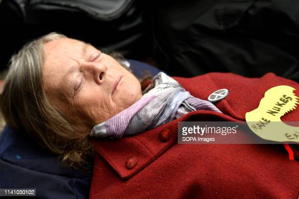 Activist seen performing a diein during the protest Antinuclear activists gathered opposite Westminster Abbey in London to protest against a service...