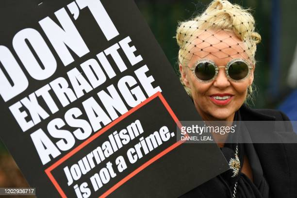 A activist supporting WikiLeaks founder Julian Assange holds a placard calling for his freedom outside Woolwich Crown Court in southeast London on...